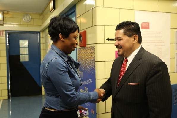 Chancellor Shakes Hands with Principal Fabayo McIntosh-Gordon of BCCS