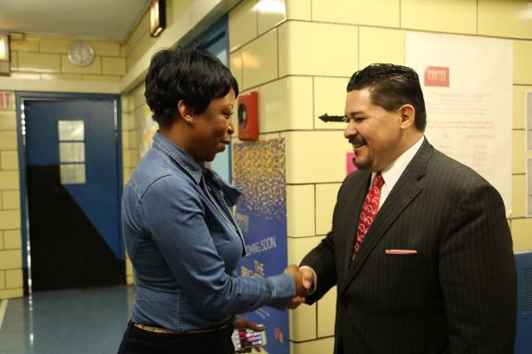 Chancellor Shakes Hands with Principal Fabayo McIntosh-Gordon of BCCS