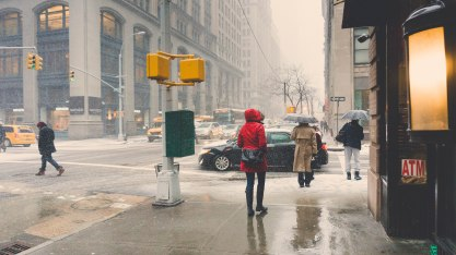 View of NYC street corner during the start of a winter storm.